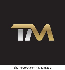 TM company linked letter logo golden silver black background