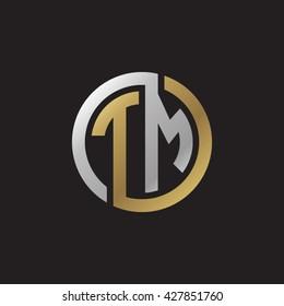 TM initial letters looping linked circle elegant logo golden silver black background