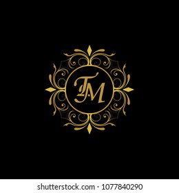 TM Initial logo. Ornament ampersand monogram golden logo black background