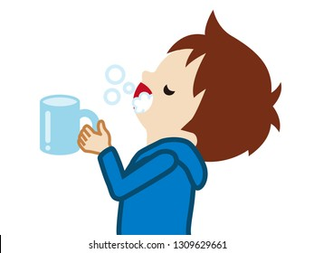 Toddler boy gargling with water for prevent cold