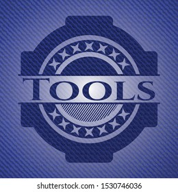 Tools emblem with jean texture. Vector Illustration. Detailed.