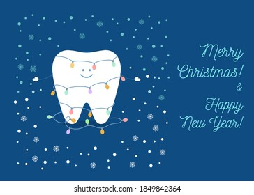Tooth is wearing colorful christmas light bulbs string celebrate Christmas and New Year.  Greeting card from a dentist to patients.