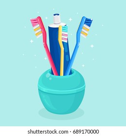 Toothbrushes and tube of toothpaste for family in toothbrush holder isolated on background. Teeth care, oral hygiene. Everyday routine. Dental concept. Bathroom accessories. Vector flat illustration