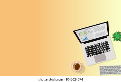 Top aerial View of business desk table with laptop and business graph on screen,a cup of coffee, notebook,wireless keyboard,small tree and copy space for text