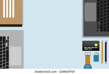 Top down flat view of table  with laptop, mobilephone, credit card,tablet,watch, pencil,rubble and copy space for text