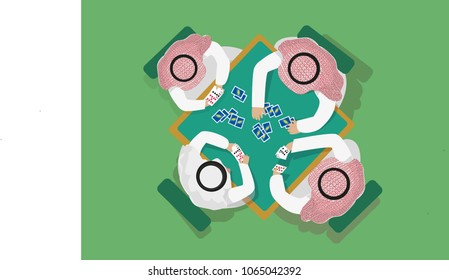 Top View of Arab Men Playing the Trick Game called Baloot which has similarity to the French belote.