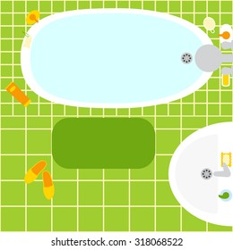 Top view of bathroom interior. Green ceramic tile, bathtub full of water, washbasin, pumice in shape of fish, oval loofah wisp, bottles, soap, rounded rectangle mat, pair of orange slippers. Flat lay