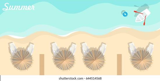 Top view of beach, sea, beach umbrellas and boats