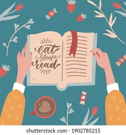 Top view female hands holding an open book. Table with Cup of coffee , flowers, branches and sweeties.. Cozy spring concept in flat cartoon style. Eat, sleep, read - lettering quote.