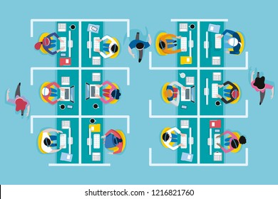 Top view of an office call center with workers working with computers and headset in cubicles.