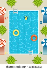 Top view of pool with sun loungers and umbrellas, palm trees and