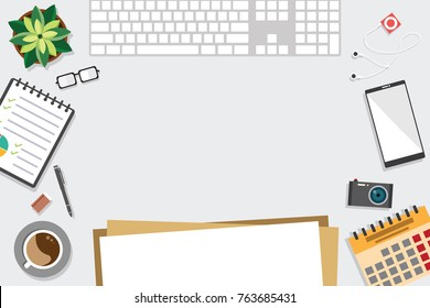 Top view of table working and working desk with gadget and free space for text with accessory on the table, notebook, keyboard, pencil, pen, coffee cup, glasses, flowerpot, camera, note