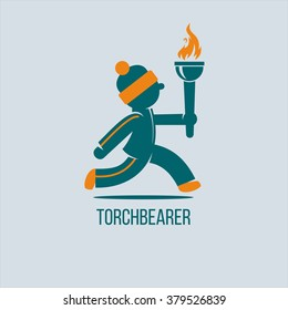 Torchbearer. The winter games. The athlete runs with the flame.