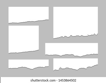 Torn sheets of paper. A set of torn paper and strips of paper on a dark background. Vector illustration.