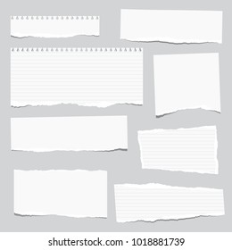 Torn white note, notebook paper strips stuck on gray background.