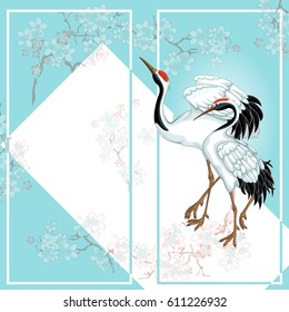 Tourist, greeting or souvenir card in the Japanese style with a pair of cranes and cherry blossoms. Gentle blue background. A frame for text. Vector illustration.