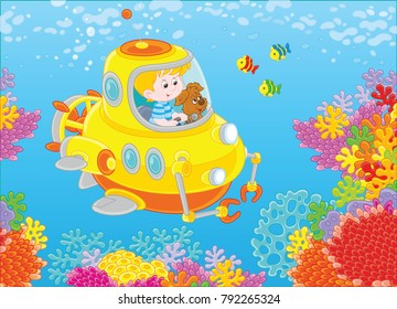A toy deep-sea bathyscaphe piloting by a little boy with his pup exploring a colorful coral reef with funny fishes in a tropical sea. A vector illustration in cartoon style.