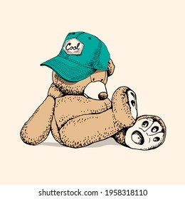 Toy Teddy bear in the blue-green cap. Funny pose. Humor textile composition, hand drawn style print. Vector illustration.