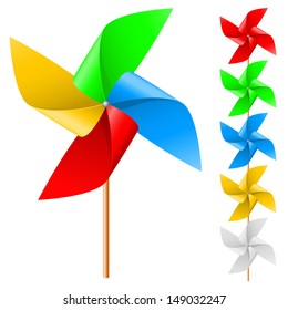 Toy windmill propeller set with multicolored blades on a white