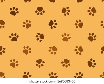 Traces of a cat. Footprints for wrappers and fabric. Seamless repeating vector pattern. Pet products design concept. Brown footprints on yellow background. Accidental disposition and direction of paws
