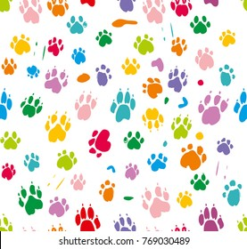 Traces of dog paws in colorful colors. Bright seamless pattern.