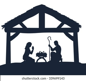 Traditional Christmas Nativity Scene of baby Jesus in the manger with Mary and Joseph in silhouette