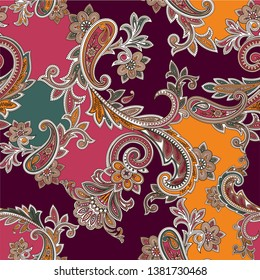 traditional colorful seamless ornamental paisley pattern for fabrics or textile design