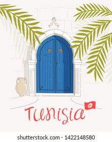 Traditional entry blue door. Olive branch. Amphora. Tunisia