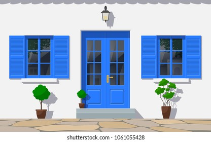 traditional greek house facade with double door and windows front view