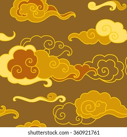 Traditional oriental ornament in golden tones. Clouds on the sky. Vector seamless pattern