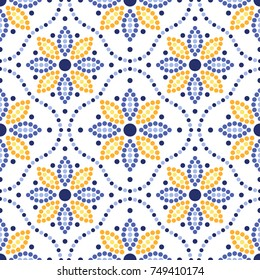 Traditional Portugal azulejos inspired seamless pattern for wall and floor home ceramic design. Dotted blue, yellow and orange print of beads in trellis and mosaic sunflowers.  Vector Illustration.