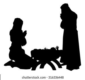 Traditional religious Christian Christmas Nativity Scene of baby Jesus in the manger with Mary and Joseph in silhouette