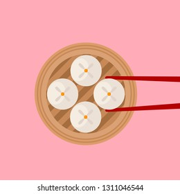 Traditional Siopao steamed buns with red chopsticks on pink background