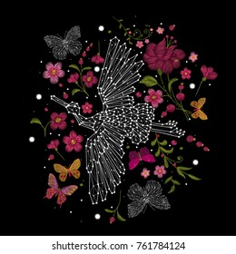 traditional stylish stylish embroidery on the black background. cranes fly and plants. constellation of birds, abstract style. sketch for printing on clothes. vector. trend