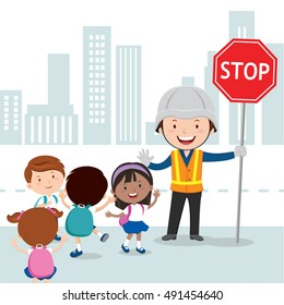 Traffic guard helping kids crossing road by holding a stop sign
