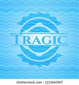 Tragic sky blue water wave style badge.
