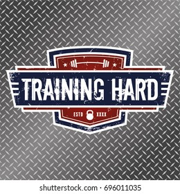 Training Hard - Vector Illustration. A grunge style logo featuring a kettlebell and a barbell.