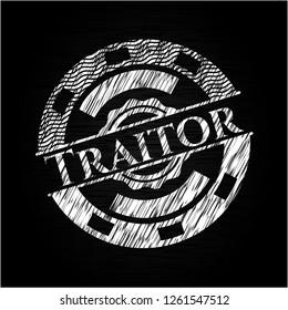 Traitor chalk emblem written on a blackboard