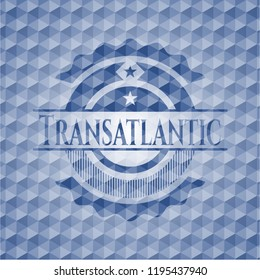 Transatlantic blue emblem with geometric background.