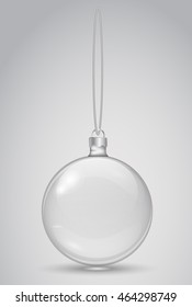 Transparent Christmas ball on a white background. Template Christmas toys. Vector realistic object.  Glass bead and thread. 10 EPS