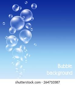 Transparent soap bubbles on blue background