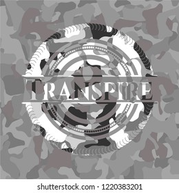 Transpire written on a grey camouflage texture