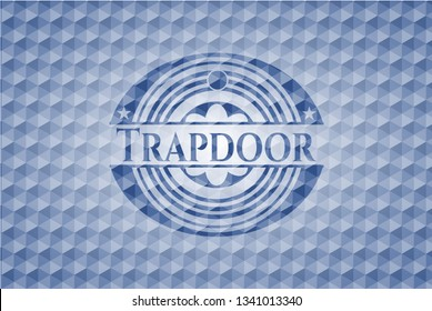 Trapdoor blue badge with geometric pattern background.