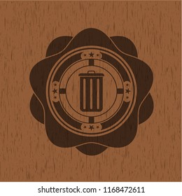 trash can icon inside badge with wood background