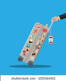 Travel bag in hand. Plastic case with stickers. Trolley on wheels. Labels of countrys and citys all over the world. Baggage and luggage. Vector illustration in flat style