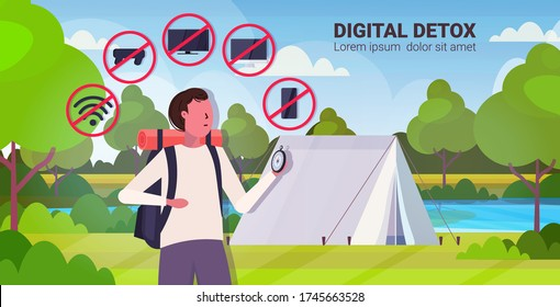 traveler with backpack holding compass gadgets in red prohibition signs digital detox concept guy hiker abandoning devices campsite background horizontal portrait vector illustration