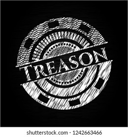 Treason chalk emblem written on a blackboard