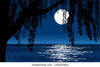 Tree against full moon during night