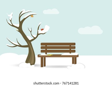 tree and a bench with snow on them and foliage. Late Autumn, early winter