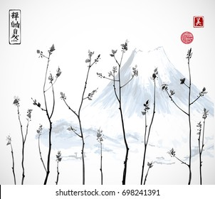 Tree branches with fresh leaves and Fujiyama mountain on background. Traditional oriental ink painting sumi-e, u-sin, go-hua. Contains hieroglyphs - zen, freedom, nature, beauty.